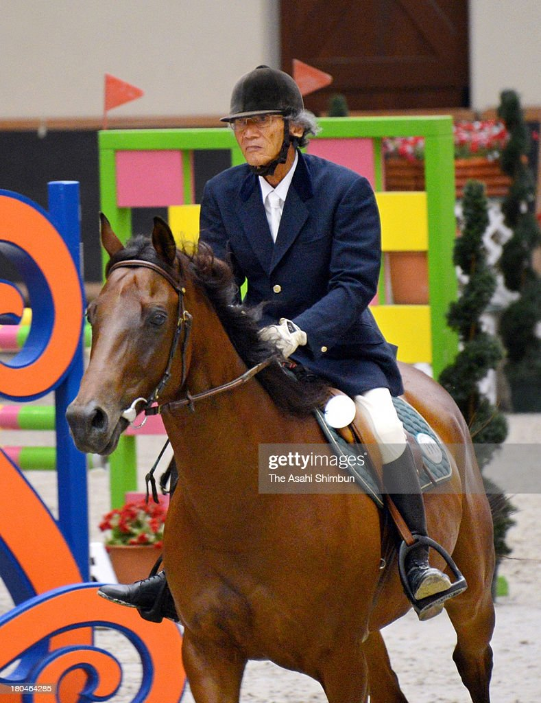 85-year-old Toru Iwatsubo competes in the All Japan Equestrian Jumping Part II at Miki Horse Land Park on September 13, 2013 in Miki, Hyogo, Japan.