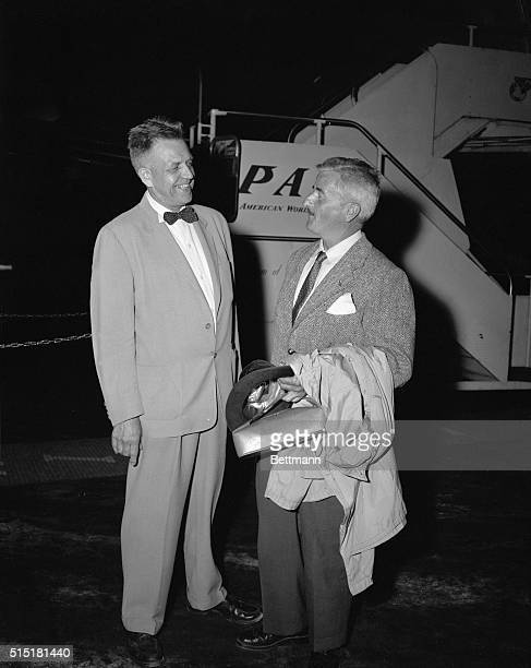 8/6/1954Miami FL Boarding a Pan American World Airways clipper for a flight to Lima Peru are Dr Alfred C Kinsey author of the famed Kinsey reports...