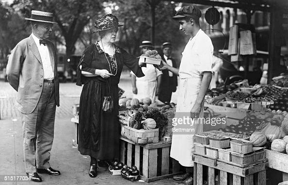 8/7/1922Secretary of Agriculture Henry Cantwell Wallace and his wife May making purchase at Central Market Photograph August 7 1922