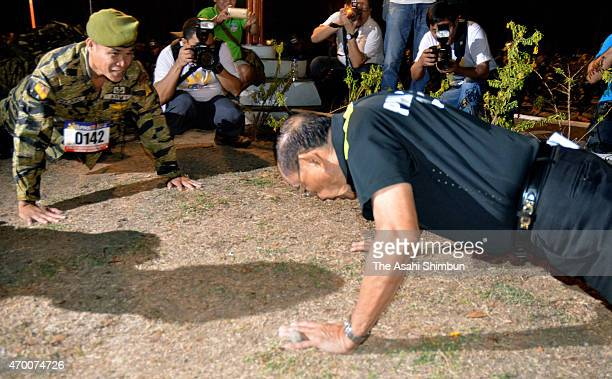 87yearold former Philippines President Fidel Ramos does pushups prior to the reproduction event of the Bataan Death March on April 11 2015 in Capas...