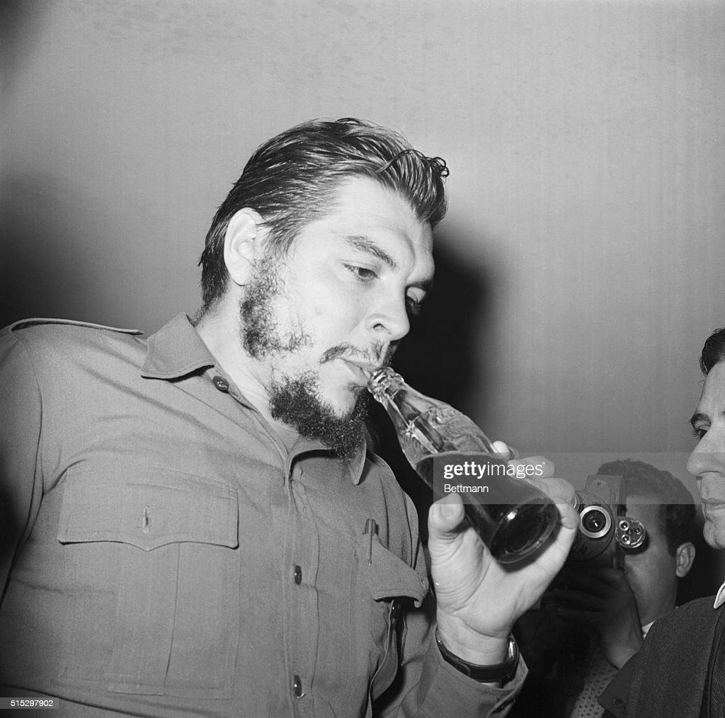 Che Guevara drinking what appears to be a bottle of Coke