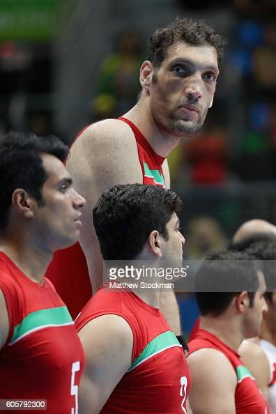 8ft 1in Morteza Mehrzadselakjani of Iran stands for the national anthem of each team before playing Ukraine at the RioCentral Pavilion 6 during day 7...