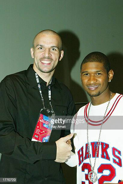 Jason Kidd of the New Jersey Nets and Usher prior to the NBA Read To Achieve Celebration on February 8 2003 at the Georgia World Congress Center in...