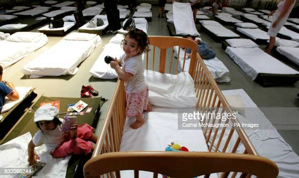 8monthold Lebanon evacuee Karen Akouri in a large warehouse at the Akrotiri RAF Base in Cyprus where the evacuees will stay until returning to the UK