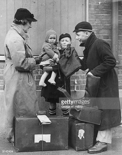 Mrs Clarke from Ruckholt Central School in Leyton East London checking that some of her soon to be evacuated pupils have all their belongings before...