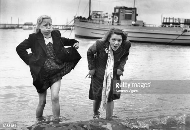 Two women find the water a little cold when paddling in the harbour at Southend