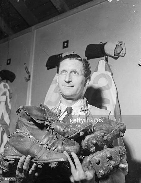 Bill Layton of Harwich FC with an armful of football boots in the changing rooms