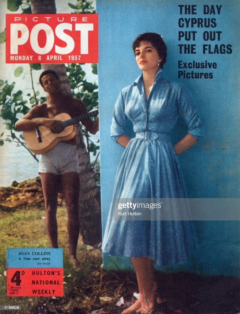 A young man with a guitar serenades British actress Joan Collins, on the cover of Picture Post magazine. The star has just finished filming Bob McNaught's 'Sea Wife', in which she plays a nun marooned on a Pacific island. The headline above reads 'The Day Cyprus Put Out The Flags'. Original Publication: Picture Post Cover - A Desert Isle And You - pub. 1957