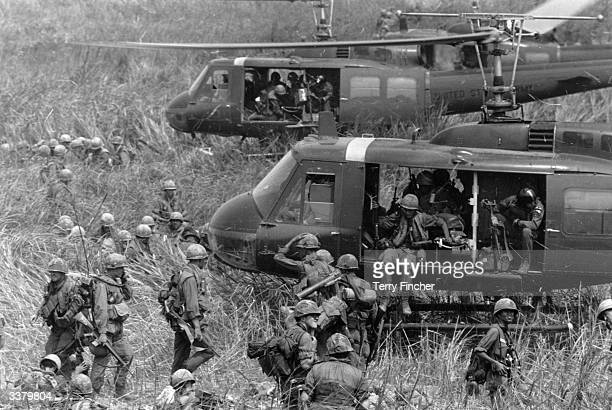 The Air Cavalry of the United States Army move from their command post to another landing zone during the Vietnam War using American Bell Huey...