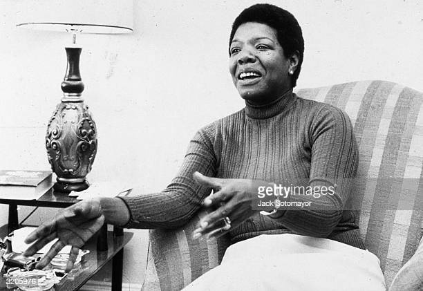 American poet and author Maya Angelou gestures while speaking in a chair during an interview at her home