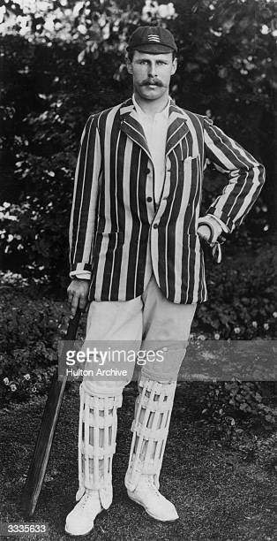 Middlesex cricketer George William Beldam wearing a striped jacket and cap with a three sword motif