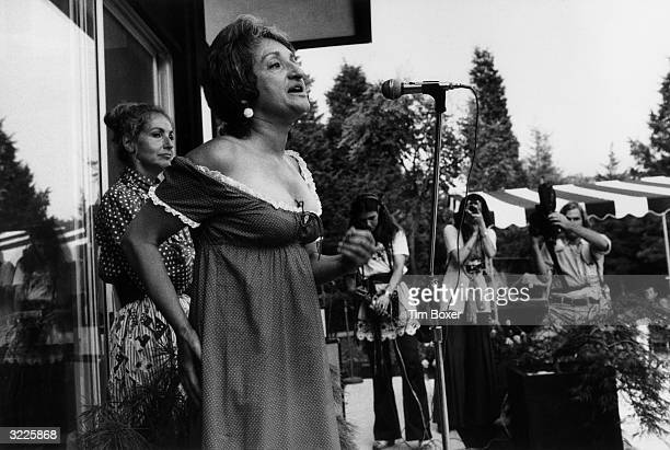 American author and feminist Betty Friedan speaks at a party thrown by arts patrons Ethel and Robert Scull in support of women's rights East Hampton...