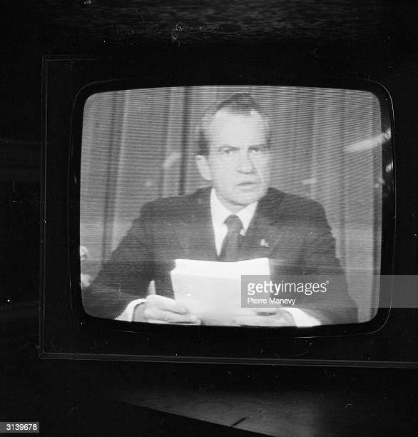 American president Richard Nixon announces his resignation on national television following the Watergate scandal
