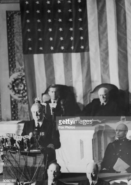 American President Franklin Delano Roosevelt addressing Congress asking for a declaration of war against Japan Speaker of the House Sam Rayburn is...