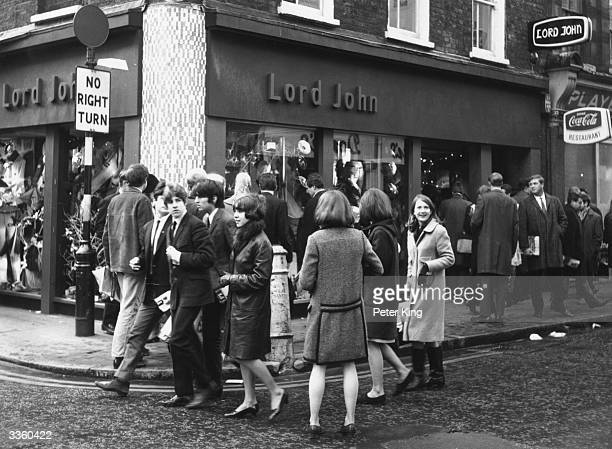 Shoppers outside the Lord John shop in Carnaby Street London