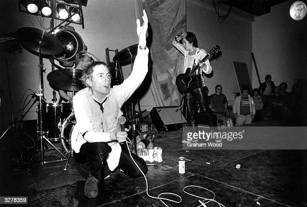 The Sex Pistols Johnny Rotten Paul Cook and Steve Jones performing on stage at Leeds Polytechnic UK