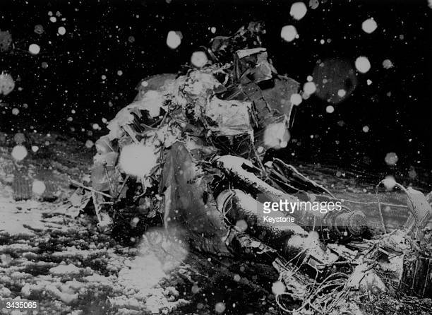 Snow falling onto the wrecked engines of a BEA Elizabethan airliner which crashed in the village of Kirchdruding soon after taking off from Munich...