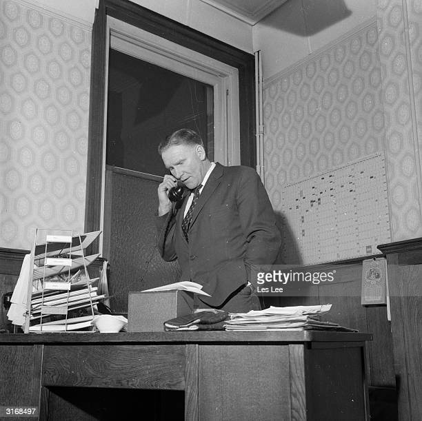 Bill Nicholson manager of Tottenham Hotspur in his office after he failed to sign Alex Scott to Spurs