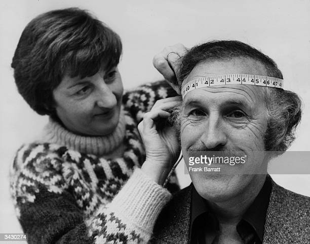 Jean Fraser of Madame Tussaud's measures comedian Bruce Forsyth's head before starting work on the first stage of his wax figure