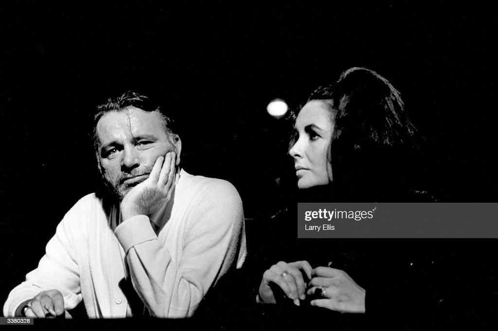 British actor Richard Burton (1925 - 1984) attending a performance of 'Dr Faustus' with his wife actress Elizabeth Taylor.