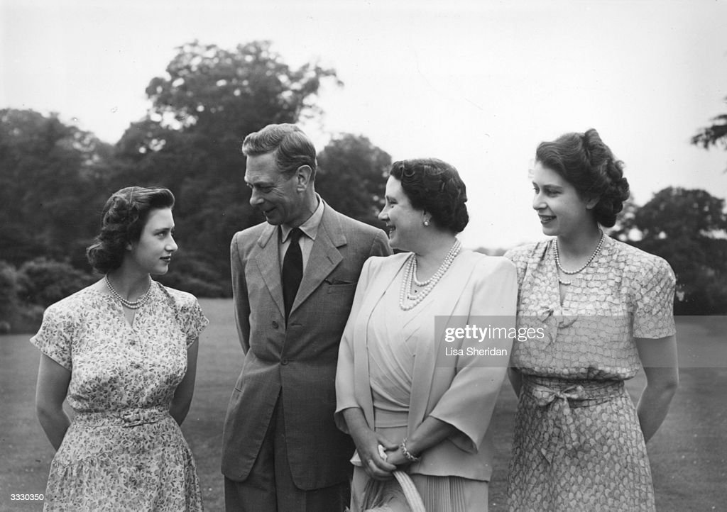 King George VI (1895 - 1952) and Queen Elizabeth with Princesses Elizabeth (right) and Margaret (1930 - 2002) in the grounds of The Royal Lodge, Windsor.