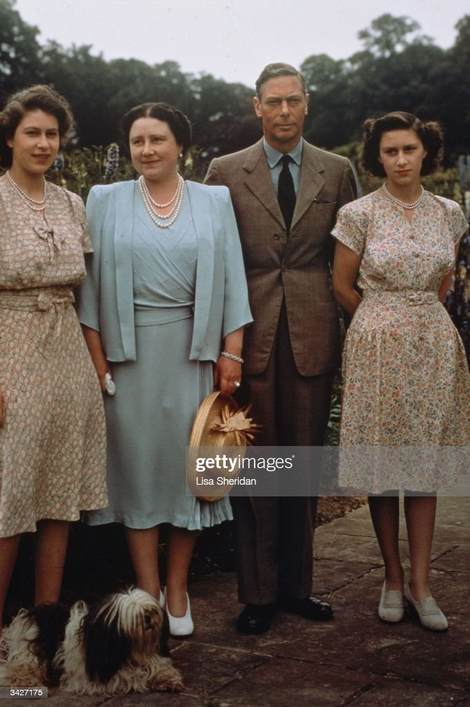King George VI with his wife Queen Elizabeth and their daughters Princess Elizabeth and Princess Margaret at Royal Lodge in Windsor