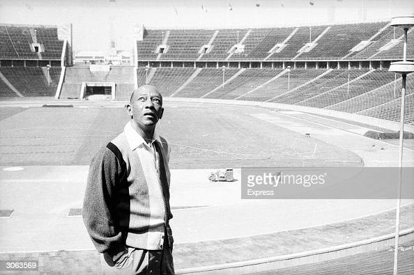 American athlete Jesse Owens winner of four gold medals at the 1936 Olympic Games revisits the Olympic stadium in Berlin the scene of his former...