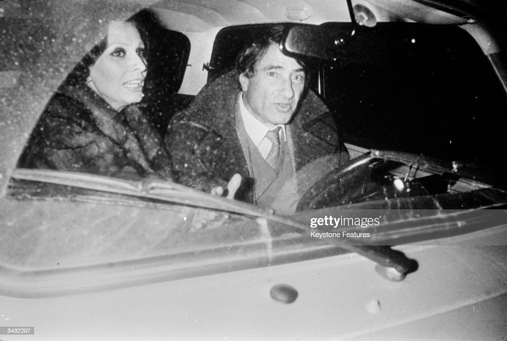 Sexy Italian film star <a gi-track='captionPersonalityLinkClicked' href=/galleries/search?phrase=Sophia+Loren&family=editorial&specificpeople=94097 ng-click='$event.stopPropagation()'>Sophia Loren</a> is spotted in Paris with Dr Emile Baulieux, adding fuel to press speculation that her marriage to producer Carlo Ponti is on the rocks.