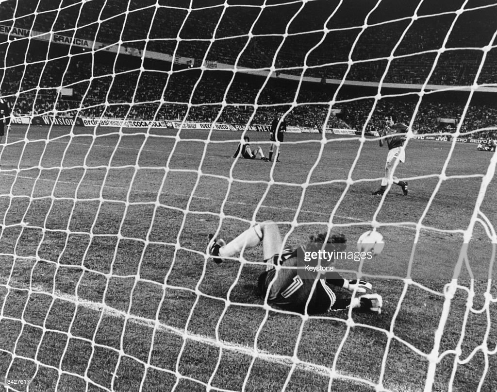 German goalkeeper Schumacher saves Bossis' shot at the goal in the penalty shoot-out after the World Cup semi-final match between West Germany and France at Sanchez Pizjuan Stadium, Seville. West Germany won the match on penalties.