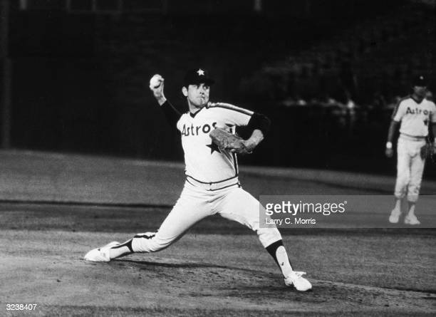 American baseball player Nolan Ryan of the Houston Astros pitches during a game against the New York Mets in which he struck out 12 batters Shea...