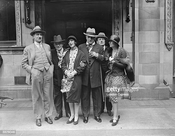 French filmmaker Sacha Guitry and actress and singer Yvonne Printemps in the Strand during a visit to London to appear in a concert