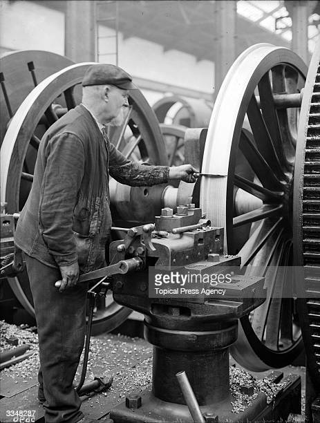 Gauging the surface of the big driving wheels of the Coronation Engine at the London and North Western Railway works at Crewe Cheshire