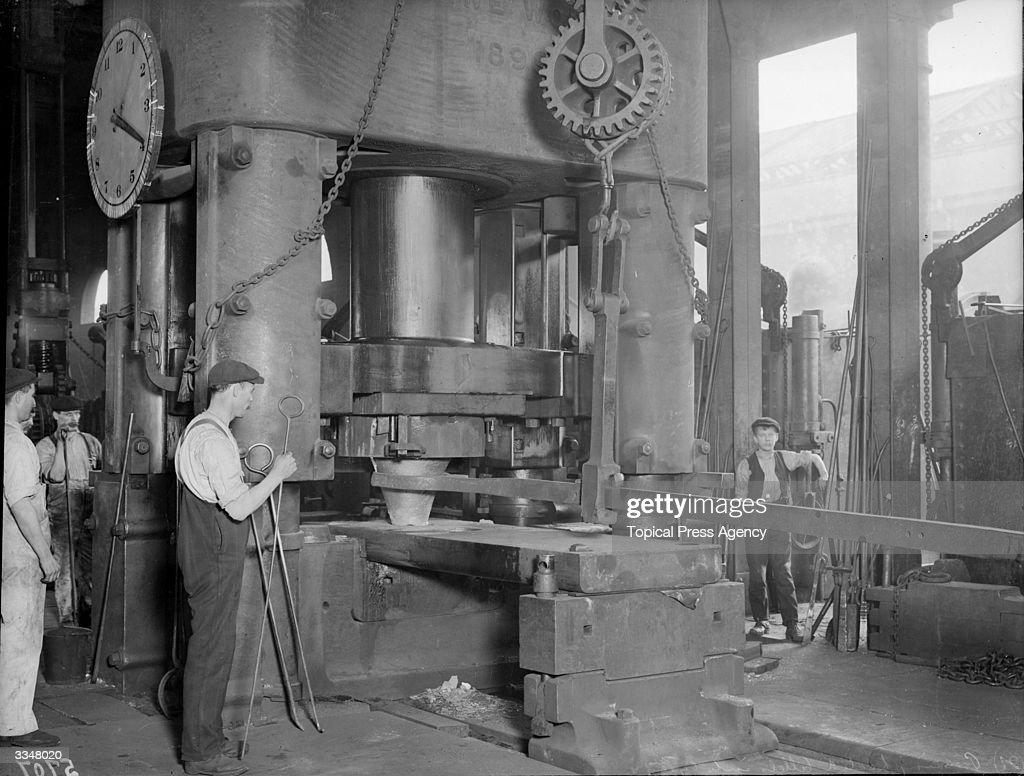 Pressing heated billets into tyres during the manufacture of the Coronation Engine at London and North Western Railway works in Crewe Cheshire