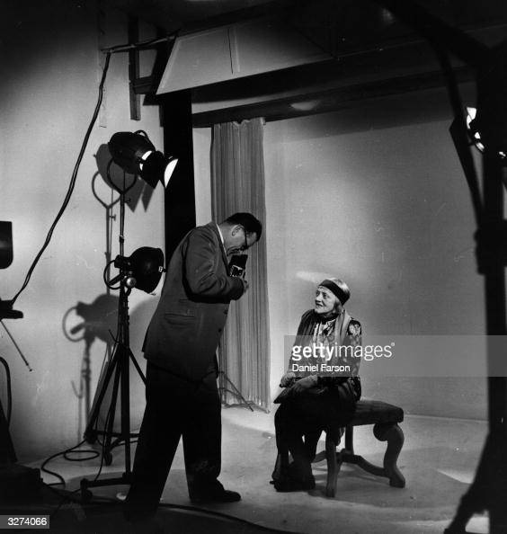 Ada Reeve who plays the part of Mrs Crockett in the film 'I Believe In You' is being photographed by one of the Ealing studio photographers Original...