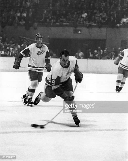8th March 1965 Canadian hockey player Gordie Howe right wing for the Detroit Red Wings handles the puck during a game against the New York Rangers