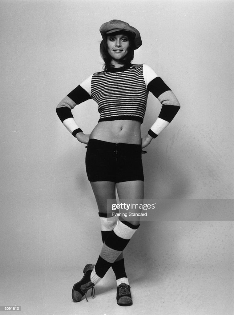 A model wearing knitted hot pants longsleeved striped sweater and kneelength socks