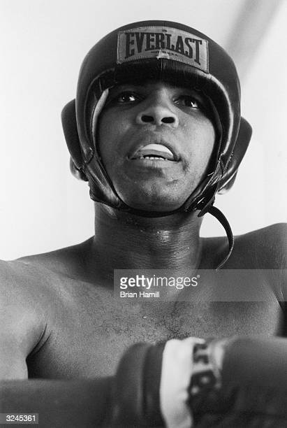American boxer Muhammad Ali formerly Cassius Clay wearing a helmet and mouthguard before his fight with Joe Frazier