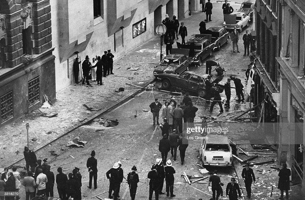 Police and emergency services amid the debris outside the Old Bailey, London, after a car bomb exploded. The Provisional IRA claimed responsibility.