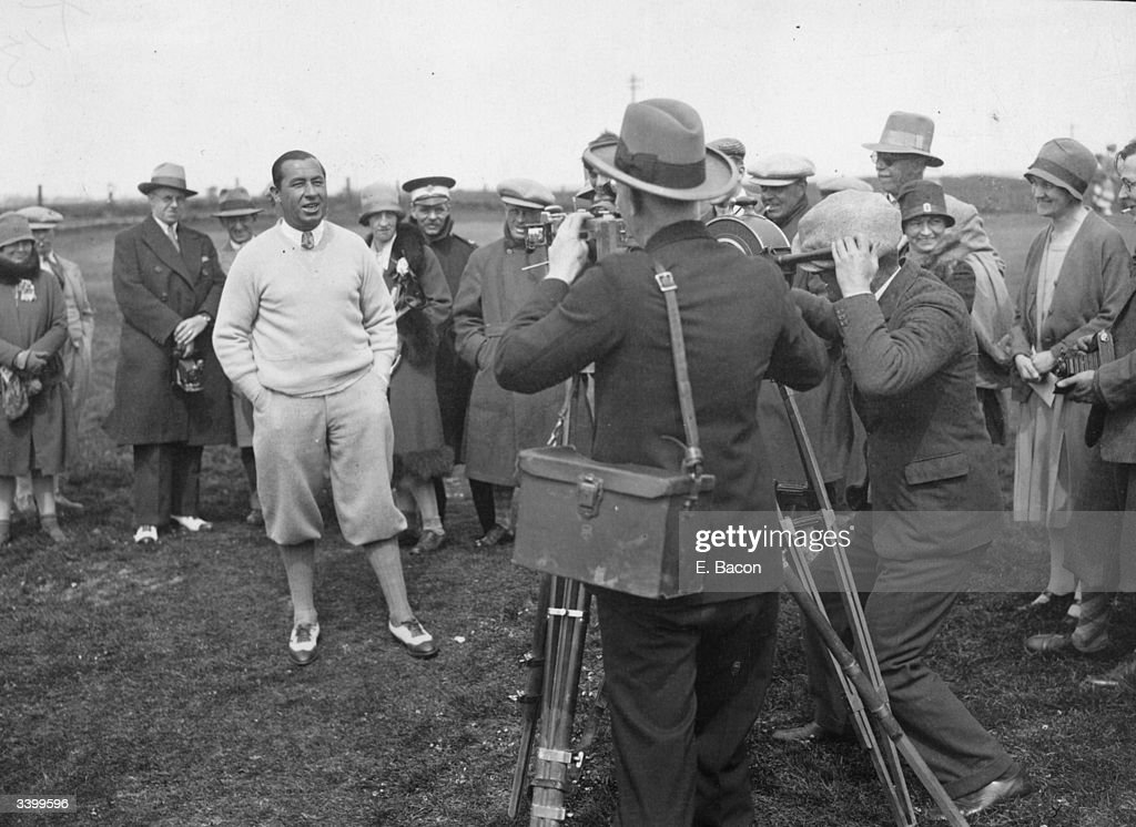 US golfer Walter Hagen winner of the USPGA and Ryder Cup Captain facing cine cameras at Sandwich after qualifying for the British Open Championship...