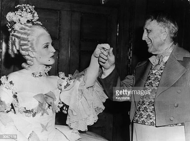 Canadian actress Norma Shearer with the newspaper magnate William Randolph Hearst at his birthday party in Marion Davies house in Santa Monica...