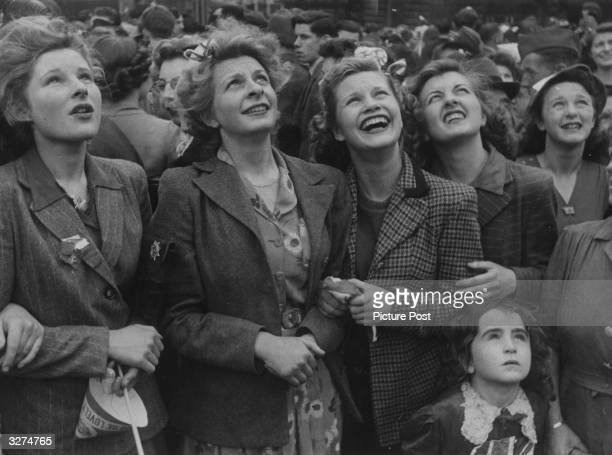 A group of women watch the VE Day celebrations in London Original Publication Picture Post 1991 This Was VE Day In London pub 19th May 1945
