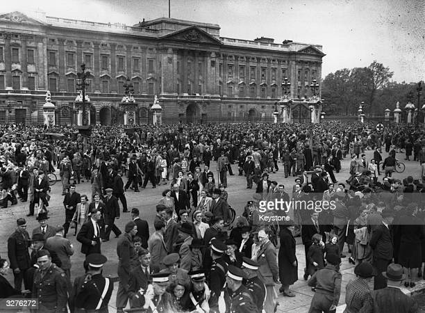 Crowds gather outside Buckingham Palace on VE Day in the hope of seeing the King