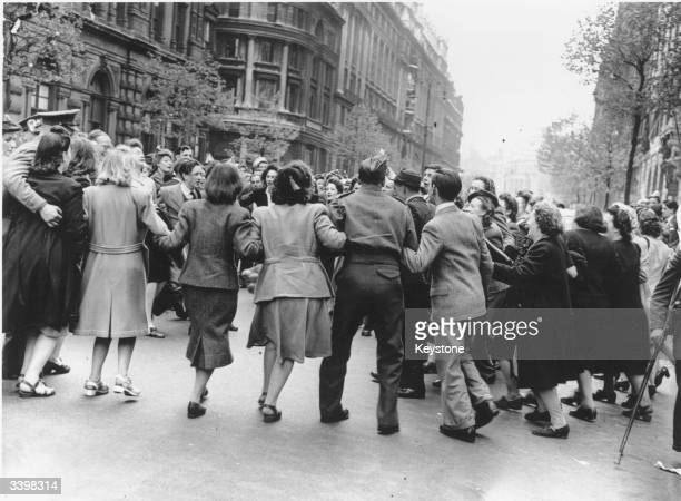 Some of the huge crowd who were in Whitehall London to hear Churchill's speech on VE Day