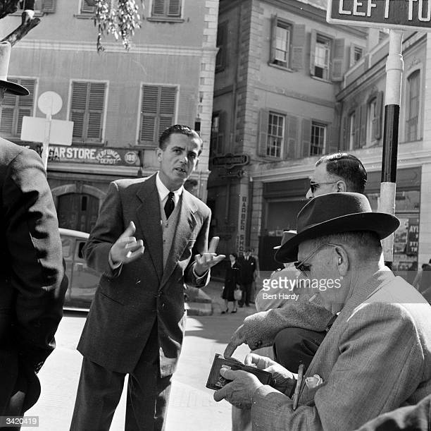 A man asking for money on a street corner in Gibraltar Original Publication Picture Post 7154 Why We Must Keep Gibraltar pub 1954