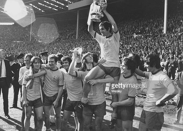 Arsenal captain Frank Mclintock holds aloft the FA Cup after his team's 21 victory over Liverpool