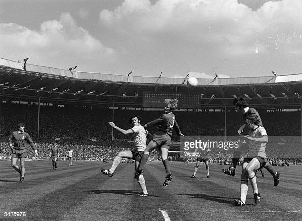 Liverpool defender Lindsay heading the ball away from Arsenal's Ray Kennedy and John Radford during an FA Cup final at Wembley Arsenal won 21