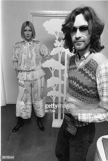 British fashion designer Ossie Clark at a London studio with a model in one of his new outfits