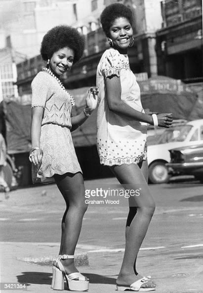 Kubi Chaza and Raye Chance wearing mini dresses