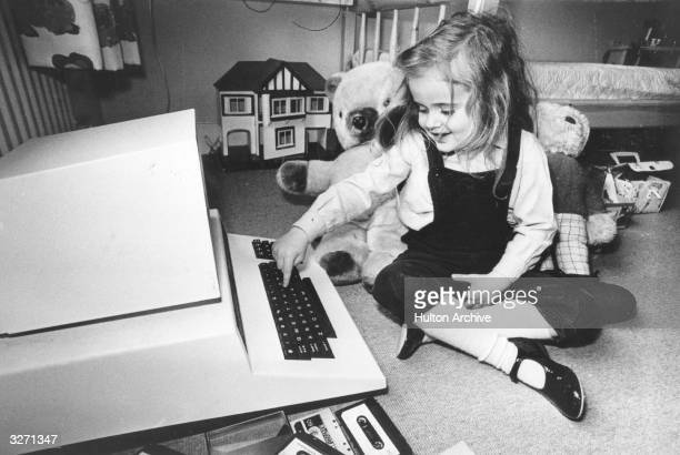 Fouryearold Antonia Salmon with one of her birthday presentsa computer which used to belong to her father