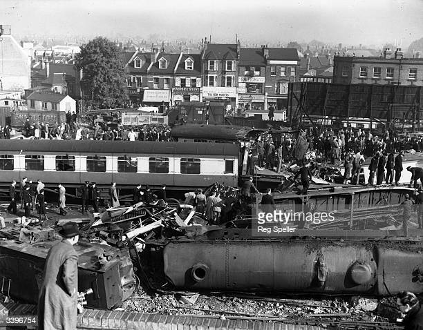 Rescue workers coping with the destruction left after a crash involving three trains at Harrow and Wealdstone station eleven miles outside of London